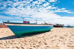 fisher boat in santa maria beach in sal cape verde - cabo verde - stock photo