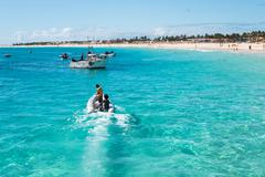 fisher boats santa maria beach in sal cape verde - cabo verde - stock photo
