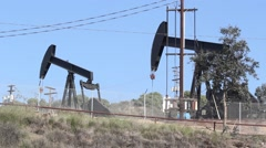 Oil Pumps Pumping in the Day Stock Footage