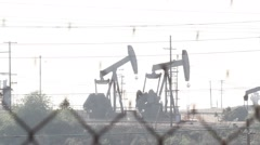 Oil Pumps washed out sunset Stock Footage