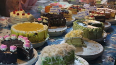 Pastry and cake at outdoor market - stock footage