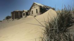 Abandoned house in desert ghost town Kolmanskop, Namibia, dolly move - stock footage