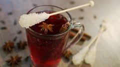 Mulled wine in a mug with clove, cinnamon and anise Stock Footage