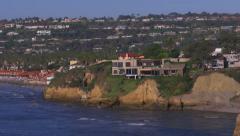 La Jolla Shores Tilt Down Shot Showing Cliff Homes Stock Footage