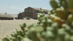 Abandoned houses in desert ghost town Kolmanskop, Namibia, Reavealing dolly move Stock Footage