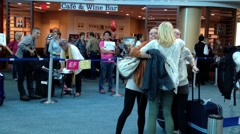 Woman hugging her friend at internation arrival lobby Stock Footage