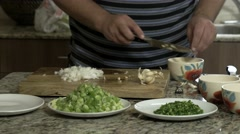 Man cutting and preparing food Stock Footage