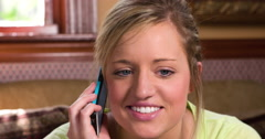 Young Female on couch talking on phone 4k Stock Footage