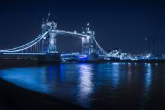 Illuminated iconic bridge in cityscape at night, London, England, United Kingdom Stock Photos