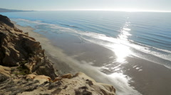 Scenic view from cliff over beach and ocean Stock Footage