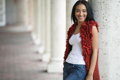 Black woman leaning on pillar Stock Photos