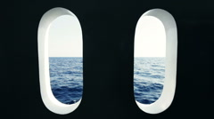 View of the Red Sea through two portholes on the ship Stock Footage