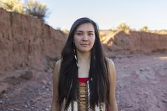 Mixed race woman standing in remote desert landscape Stock Photos