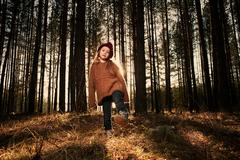 Caucasian girl playing in forest Stock Photos
