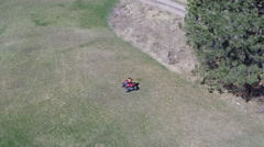Kid on ATV/ Four Wheeler Aerial Stock Footage