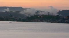 Lake Rotorua and Rotorua cityscape New Zealand at dusk Stock Footage