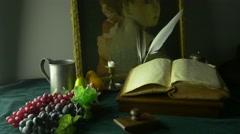 4K UHD Dolly Shot of Still Life Ancient Manuscripts Paintings and Grapes Stock Footage