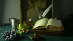 4K UHD Dolly Shot of Still Life Ancient Manuscripts Paintings and Fruit Stock Footage