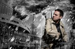 killer standing on dark city background to kill - stock photo