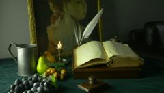HD Dolly Shot of Ancient Manuscripts Paintings and Fruit Stock Footage