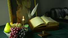 HD Dolly Shot of Ancient Manuscripts Paintings and Grapes Stock Footage