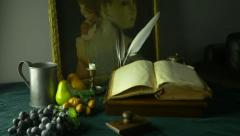 HD Dolly Shot of Still Life Ancient Manuscripts Paintings and Fruit Stock Footage