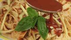 Fresh Basil On Pasta With Sauce Poured. Stock Footage