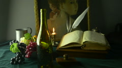 HD Dolly Shot of Wine Bottle and Ancient Manuscript and Painting - stock footage