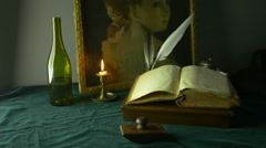 HD Dolly Shot of Wine Bottle and Antique Manuscript against Painting - stock footage
