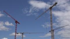 ULTRA HD 4K Crane equipment work construction site blue sky built house machine Stock Footage