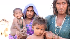 Beggar women and children begs for money from a passerby,India Stock Footage