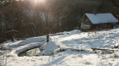 The old wooden hut in the winter woods near a source of water Stock Footage