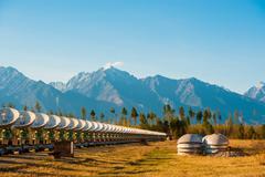 Satellite dishes on summit at sun day - stock photo