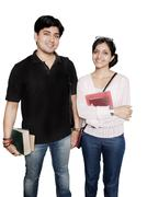 two cheerful indian college students over white. - stock photo