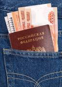 russian rouble bills, train tickets  and passport in the back jeans pocket - stock photo
