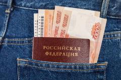 Russian rouble bills, train tickets  and passport in the back jeans pocket Stock Photos