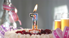 Birthday Candle on top of cake (number ONE) Stock Footage