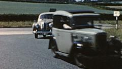 England 1955: group of cars running in the street Stock Footage