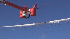 Workers remove ice from power lines after ice storm Stock Footage