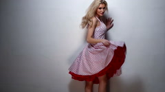 Blond Woman in Side View in Red Pink Dress Stock Footage