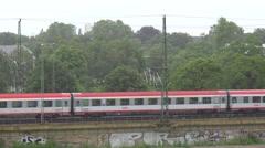 ULTRA HD 4K German passenger train pass rainy day storm rain day people commute  Stock Footage