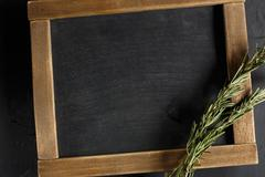 Herbs and spices with chalk board for text or recipes. - stock photo