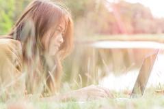 Women smile feel happy use laptop computer outdoor Stock Photos