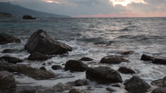 Beautiful sea landscape with waves and stones at sunrise Stock Footage