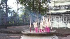 Burning incense in thai temple Stock Footage