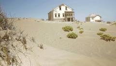 Abandoned houses in desert ghost town Kolmanskop, Namibia, Revealing Tilt Stock Footage