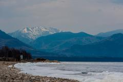 Day at Baikal Lake. Spring floating of ice - stock photo