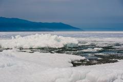 Day at Baikal Lake. Spring floating of ice - stock photo