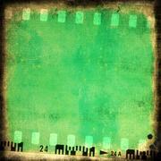 Grunge green film strip background Stock Illustration