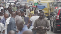 Stock Video Footage of Slo-mo Bustling Lagos Street